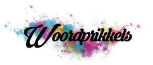 Woordprikkels in sierlijke letters op een achtergrond met verfvlekken